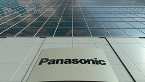 Signage board with Panasonic Corporation logo. Modern office building facade time lapse. Editorial 3D rendering