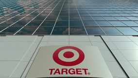 Signage board with Target Corporation logo. Modern office building facade time lapse. Editorial 3D rendering