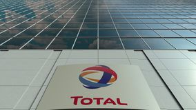 Signage board with Total S.A. logo. Modern office building facade time lapse. Editorial 3D rendering