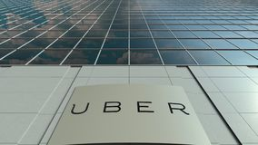Signage board with Uber Technologies Inc. logo. Modern office building facade time lapse. Editorial 3D rendering. Outdoor signage board with Uber Technologies stock video