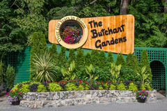 Signage for Butchart Gardens, Victoria, BC, Canada. Sign in flower beds outside Butchart Gardens in Victoria, British Columbia, Canada on sunny day stock photography