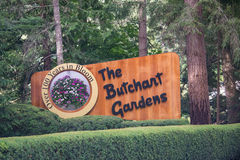 Signage, Butchart Gardens, Victoria, Canada. Signage in manicured shrubs and pine trees for Butchart Gardens in Victoria, British Columbia, Canada stock photography