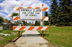 Signage of a closed sidewalk Royalty Free Stock Photography