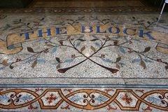Colorful mosaic tiling in foliage pattern at entry to Victorian shopping mall of historic Block Arcade in Melbourne CBD, Australia stock photos