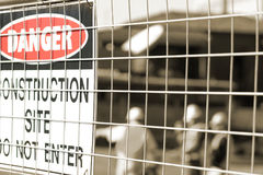 Signage and construction workers stock images