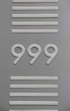 Signage de nombre de 999 3 nines avec les barres horizontales Photographie stock libre de droits