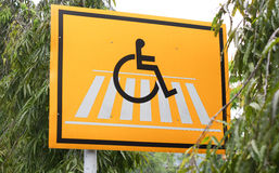 The signage of disable people and zebra crossing Stock Photography
