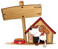 A signage beside a doghouse Royalty Free Stock Photos