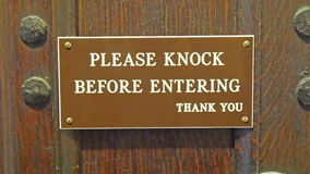 A signage on the door saying knock first stock video