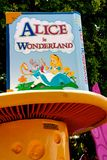 Disneyland Alice in Wonderland Signage. Signage at the entrance to the Disneyland Alice in Wonderland ride. The park resort has thousands of visitors every day royalty free stock image