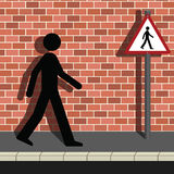 Signage Man Walking Along a Street Stock Photo