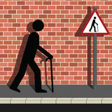 Signage Old Man Walking Along a Street Stock Photography