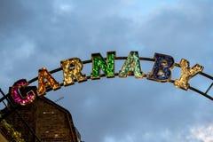 Signage på den Carnaby gatastaden av Westminster, London Arkivbild
