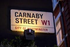 Signage på den Carnaby gatastaden av Westminster, London Royaltyfri Fotografi