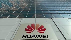 Signage raad met Huawei-embleem Moderne de bureaubouw voorzijde Het redactie 3D teruggeven Stock Foto