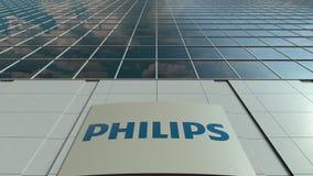 Signage raad met Philips-embleem Moderne de bureaubouw voorzijde Het redactie 3D teruggeven Stock Afbeelding