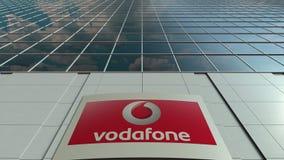 Signage raad met Vodafone-embleem Moderne de bureaubouw voorzijde Het redactie 3D teruggeven Royalty-vrije Stock Fotografie