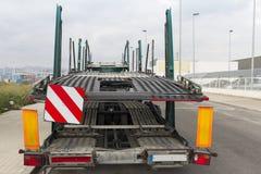 Signage on a truck platform. Signage on a platform truck for car transport by road Royalty Free Stock Images