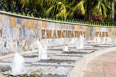 Entrance to the Emancipation Park in Kingston Jamaica. Signage and water fountains at entrance to the Emancipation Park in New Kingston, Jamaica royalty free stock photos