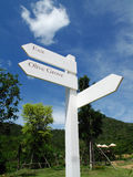Signage. White Sign post or Guide Post at the junction. Holiday at the Olive Grove in Thailand Royalty Free Stock Images