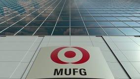 Signagebräde med MUFG-logo modernt kontor för byggnadsfacade Redaktörs- tolkning 3D Arkivbilder