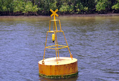 Signal buoy floating in sea Stock Image