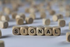 Signal - cube with letters, sign with wooden cubes Royalty Free Stock Photography