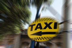 Signal de direction de taxi Photographie stock
