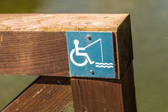 Signal for disabled people to fish Stock Photo
