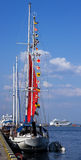 Signal flags against blue sky on yacht Stock Photos