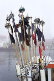 Signal flags. Collected fisherman`s signal flags flutter in the wind royalty free stock photo