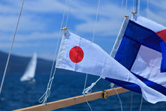Signal Flags. International Maritime Signal Flags for regatta of yachts stock image