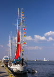 Signal flags on a sailing boat Stock Image