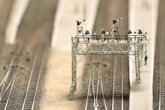 Signal gantry. Miniture railway overhead signal gantry with shallow d.o.f Royalty Free Stock Image