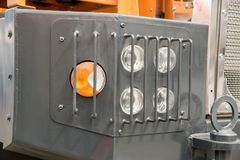 Signal headlamp protected by a grating from a heavy truck for in Royalty Free Stock Images