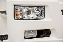 Signal headlamp protected by a grating from a heavy truck for in Stock Photo