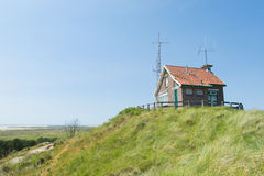 Signal house on top of dune Stock Image