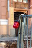 Red warning light on the fence. Signal lamp on the fence during repairs. Red warning light royalty free stock image