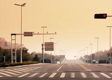 The signal lamp and a pedestrian crossing marking Royalty Free Stock Photos