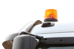 Signal lamp for warning flashing light on vehicle. Orange siren signal lamp for warning, flashing light on vehicle, industry detail Stock Images