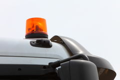Signal lamp for warning flashing light on vehicle. Orange siren signal lamp for warning, flashing light on vehicle, industry detail Royalty Free Stock Images