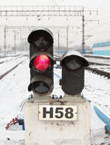 Signal light on railway. Railroad traffic signal light and train in winter Stock Images