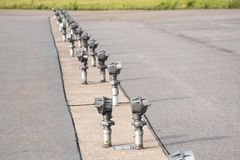 Signal lights on the runway at the airport close up. royalty free stock photography