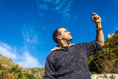 Signal. A man trying to pick up the signal on his mobile phone royalty free stock photos
