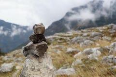 Signal marker. Mountain stone and fog Stock Photo