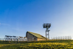 Signal repeater at mountain. Signal repeater with the control structure in the mountains of Tuscany (Italy Stock Photo