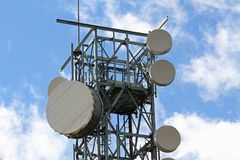 Signal repeaters technology televisions and mobile phone Stock Photo