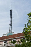 A signal tower. Behind a building Stock Images