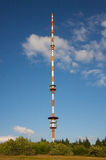 Signal Tower. A radio and TV signal tower on a high hill at sundown stock photos