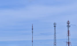 Signal tower with blue sky. Signal tower with blue sky,Communication technology  for the connection around the world Royalty Free Stock Images